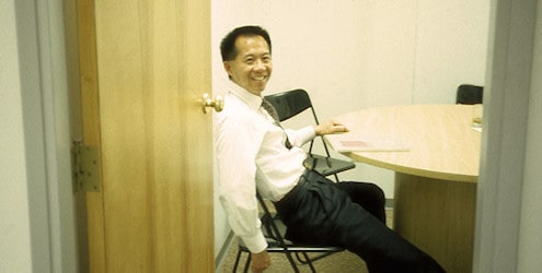 S.B. Mah in UGSL office, Vernon, BC.