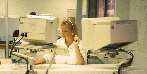 L. Peterson digitizing at an IBM GFIS workstation.