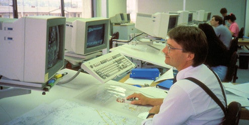 T. Proctor at a workstation.