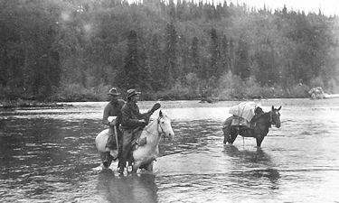 Fording the Stikine, 1913.