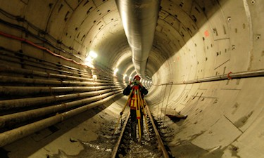 T. Hill on 5.5 Km of precise control check survey of the Canada Line tunnel under False Creek, Vancouver, 2006.