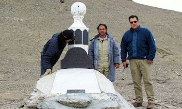 C. Kalluk, Nunasi Pilot, and C. Cryderman at the Lady Franklin Memorial, on Beechy Island, NU. During Nunavut Land Claim surveys on Devon Island, 1998.