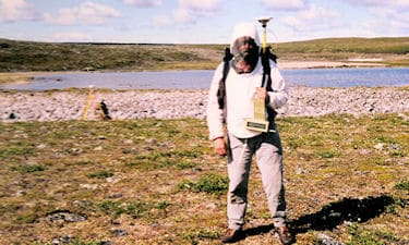 G.C. Friesen doing RTK GPS of natural boundaries on Nunavut Land Claim survey in Paulatuk, NU