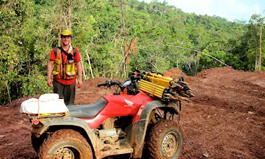 Assistant B. Elke on GPS control survey on a mining property for Strata Gold Corp. in Guyana, 2007.