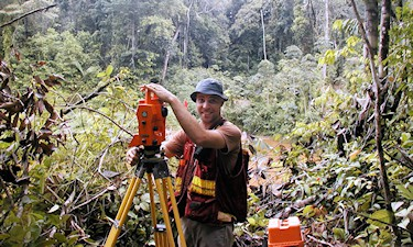 Party Chief N. Manchon on GPS control survey on a mining property for Strata Gold Corp. in Guyana, 2007.