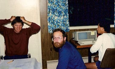 From Left: I. Royan, M. Zukiwski, and S.B. Mah, in New Denver on the Kootenay GPS photo control survey, 1986. Lack of satellites, and all day and night computing, for just a few observations, made the early days of GPS a liittle stressfull.