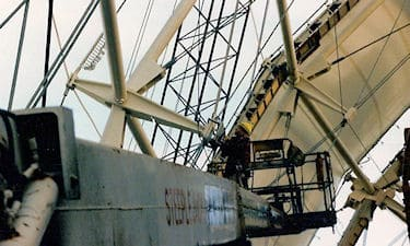 I. Royan mounting special tooling for measuring nodes of the Ontario Pavillion geodesic roof, Expo '86, Vancouver.