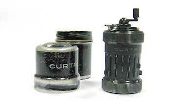 Curta hand-held hand crank calculator.