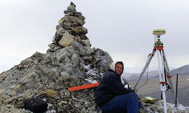 Assistant J. Pudluk on Nunavut Land Claim boundary survey, Devon Island, NU, 1998.