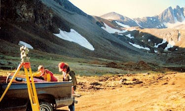 Kelly Lanigan (right), and assistant, on the Mount Skookum mineral lease survey, YT, 1987.