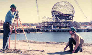 Surveying during the construction of World Expo'86 in Vancouver. Science World under construction in the background. Morgan Stewart.