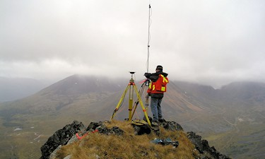Setting up the RTK Base during GPS Survey of mineral lease. Ruby, Cr., Atlin, BC.