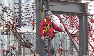 Measuring steel for the new BC Place roof. T. Hill, 2011.