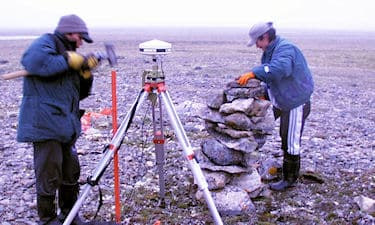 Assistants Teddy Eleehetook and Nelson Ruben on Nunavut Land Claim survey north of Gjoa Haven, NU, 1998.