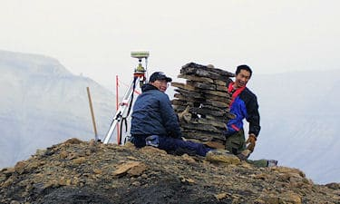 Assistants C. Kalluk, and M. Manik on Nunavut Land Claim survey. Devon Island, NU, 1998.