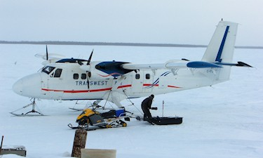 Twin Otter on Skis. Support for MWH Geo-Surveys GPS/Gravity survey for CAMECO. Russell Lake, Sask, 2007.