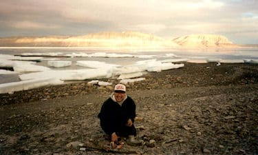 Assistant S. Inutiq on Nunavut Land Claim survey near Arctic Bay, NU, 1997.