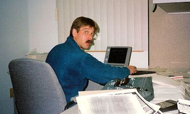 S. Brown processing GPS data in Cambridge Bay, NU on the Nunavut Land Claim survey, 1996.
