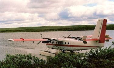 Twin Otter loading up to leave. At the Underhill Horton River camp. Inuvialuit Land Claim Boundary survey, 1988.