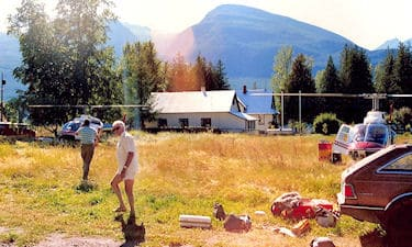 Bill Robinson loading the helicopters, in New Denver, BC, on the 1986 Kootenay GPS photo control survey.