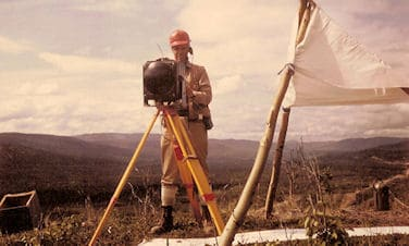 W.G. Robinson with Tellurometer MRA3, on photo control survey in BC.