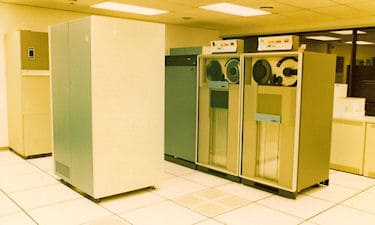 UGSL's IBM 4381 dual processor mainframe computer, with DASDY tape drives, 1991.
