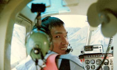 B. Wong, of MPT, in Highland Helicopter Bell 206, on GPS Ltd. TRIM Photo Control survey, 1987.