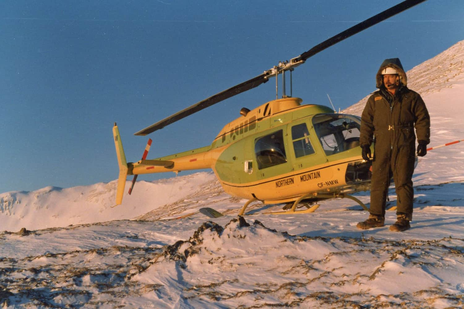 Helicopter on contorl survey for BC Rail tunnels, 1980.
