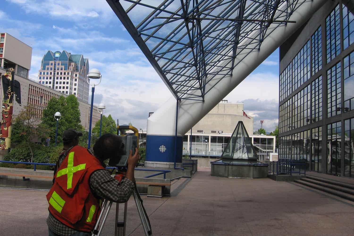 Surveying the exterior of the CBC Building, Vancouver.