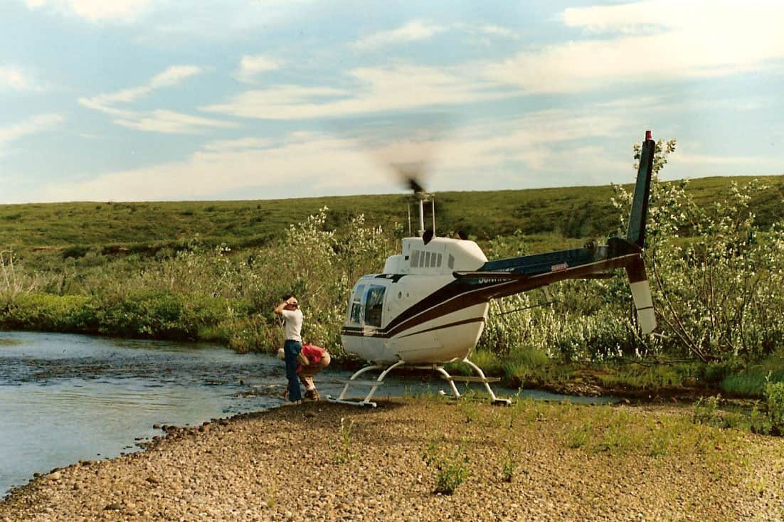 S. Jacksie (pilot) and W.G. Robinson getting water at the lake, and having a wash - near Horton River, NT, 1988.