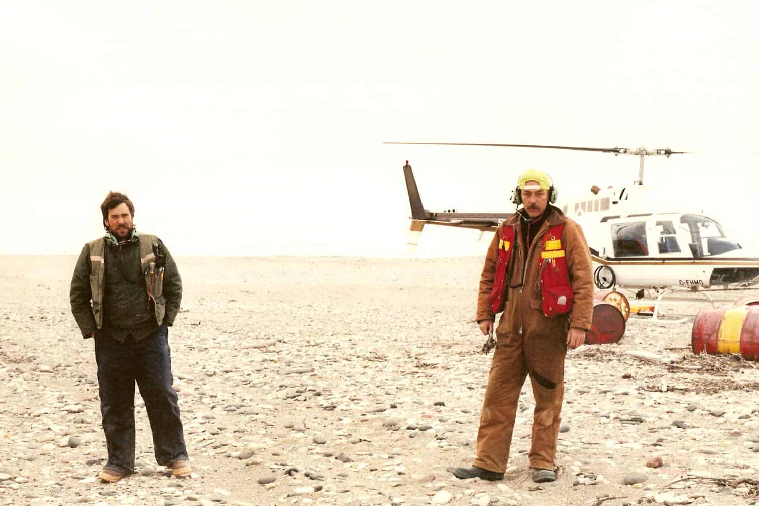 C. Cryderman and T. Connolly waiting for the Helicopter to refuel at DeSalis Bay on Banks Island during the Inuvialuit Boundary survey, 1991.