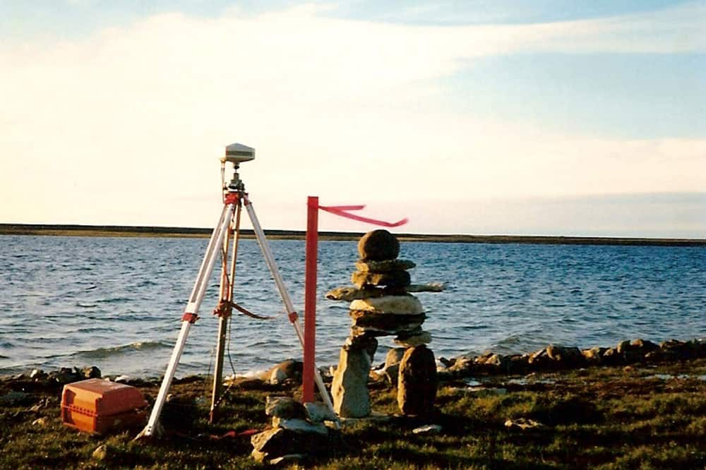 Cairn not to specifications. The pilot did it! Nunavut Land Claim survey near Cambridge Bay, NU, 1996.